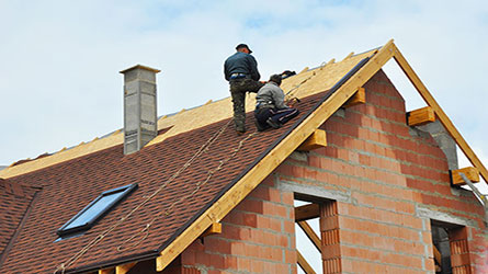 roofer working at height with personal accident cover
