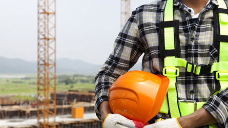 Man at work covered by site manager insurance with a hard hat on.
